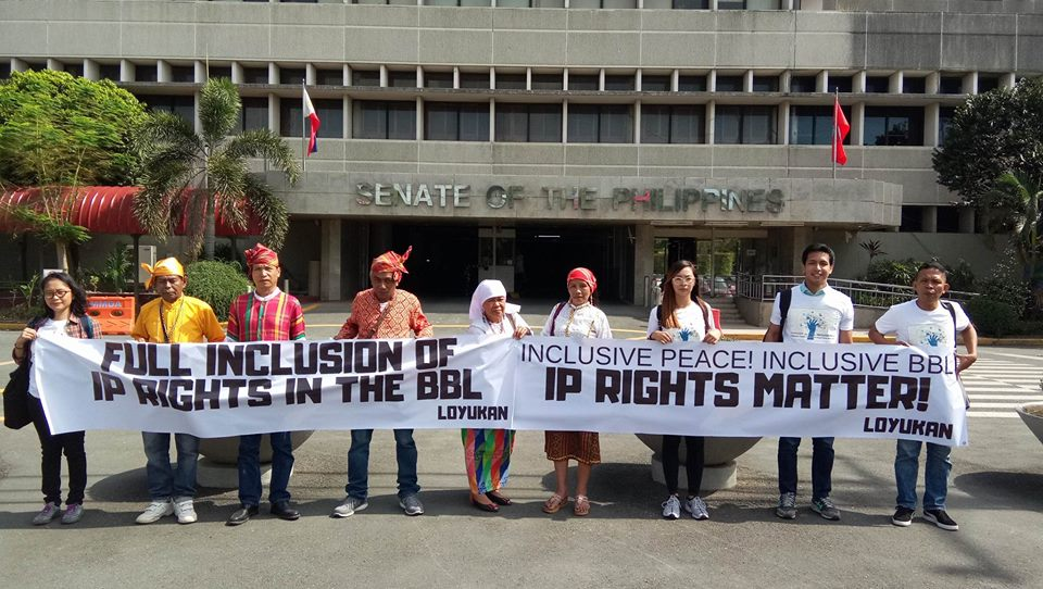"""A photo of the indigenous peoples leaders at the Philippine Senate Building holding up a banner saying """"IP Rights Matter"""". Photo by Loyukan"""