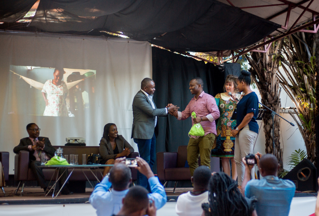 Photojournalist Imani Nsamila and Aika Kimaro receive their awards having emerged winners in the photography competition. Photo credits: Calvin K.