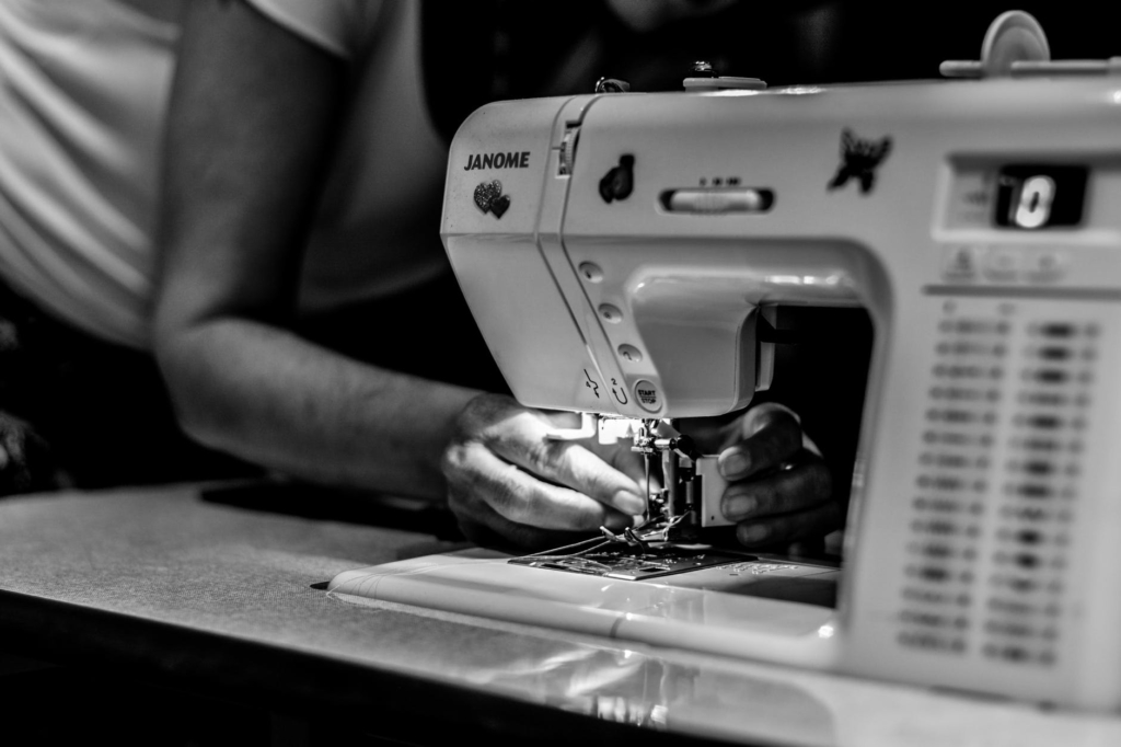 Image showing a woman using a sewing machine (Image from Pexels)